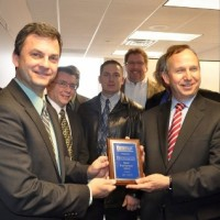 Info Solutions receives an award from Gov. Jack Markell