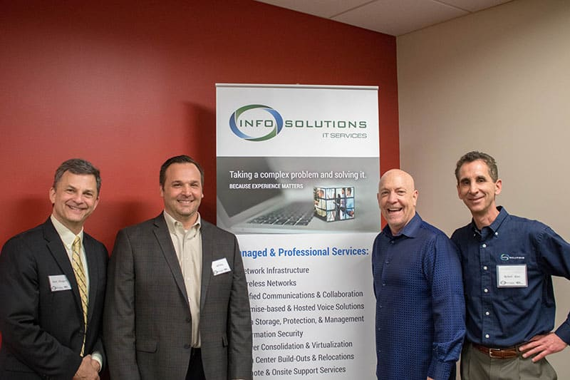 Info Solutions founders with the comedian.